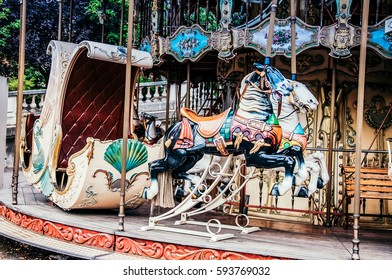 PARIS, FRANCE -20 September 2015: Carusel near Sacre Coeur in Montmartre in Paris, France. Old French carousel in a holiday park. Horses and airplane on a traditional fairground vintage carousel.