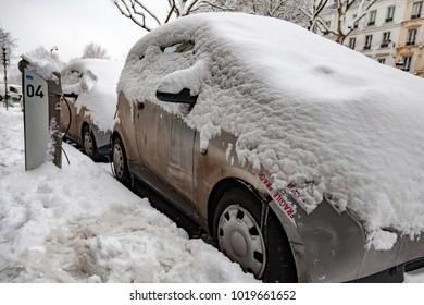 Paris, France - 2018, February 7th: Autolib car service under the snow.