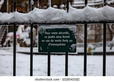 Paris, France - 2018, February 7th: Closed public park during the snow storm.