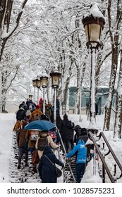 Paris, France - 2018, February 7th: Tourists on the stairs to Montmartre covered by snow.