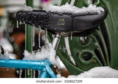 Paris, France - 2018, February 7th: Snow and ice covered bicycle seat.