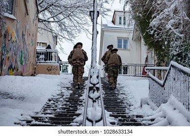 Paris, France - 2018, February 7th: French soldiers patrolling in snow covered Montmartre district.