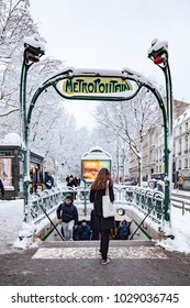 Paris, France - 2018, February 7th: Snow covered subway entrance Metropolitain in Paris France