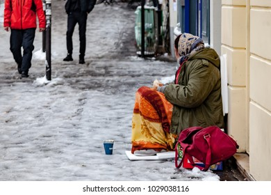 Paris, France - 2018, February 7th: Homeless on snow covered street in Paris France