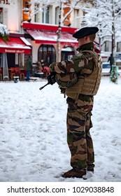 Paris, France - 2018, February 7th: Soldier patrolling at Place du Tertre in Montmartre, Paris France