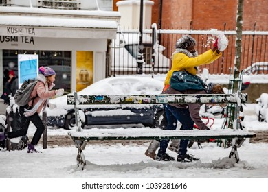 Paris, France - 2018, February 7th: Children playing with the snow.