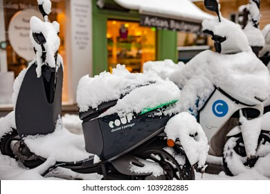Paris, France - 2018, February 7th: Snow covered scooters.