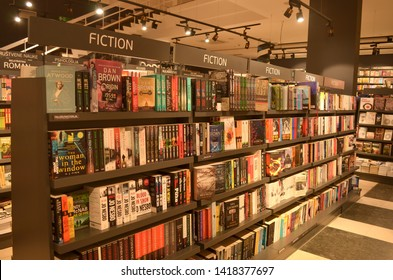 Paris, France, 2019. Books on display on shelves in a bookstore in the Fiction section in a shopping mall.