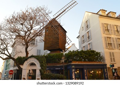PARIS, FRANCE - 22 FEBRUARY 2019: The famous windmill and cafe, Moulin de la Galette in Montmartre, painted by Renoir, Van Gogh and Pissarro and frequented by them Picasso, Toulouse-Lautrec and others