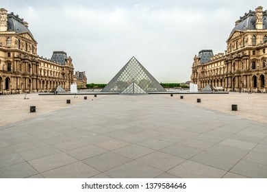 PARIS, FRANCE - 23 April 2019. The Napoleon court where the Pyramids were built by Sino-American architect Ieoh Ming Pei. The big pyramid and three small ones in the center of the courtyard.