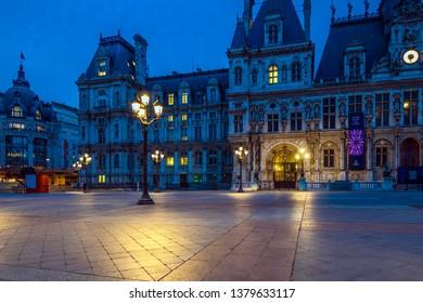 PARIS, FRANCE - 23 April 2019. 6:30 am, the Hotel de Ville in Paris wakes up slowly. On the left, the BHV department store Parisians.
