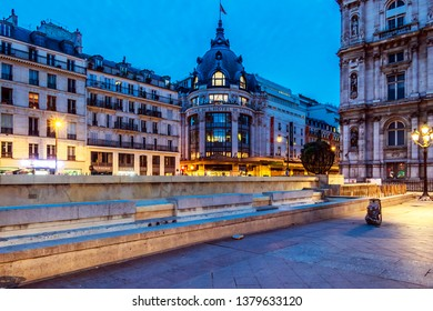 PARIS, FRANCE - 23 April 2019. 6:30 am, the BHV, Paris department store near the Hotel de Ville, is illuminated by the street lights.