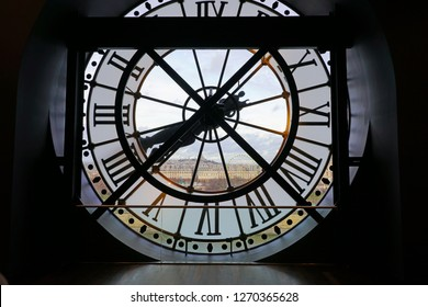 PARIS, FRANCE -23 DEC 2018-  Looking through the giant clock at the Musee d'Orsay towards the Right Bank of Paris at the Musee d' Orsay located in the former Gare d Orsay train station in Paris.