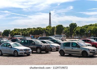 Paris, France - 23 June 2018: Traffic on Place de la Concorde with Eiffel Tower in the distance.