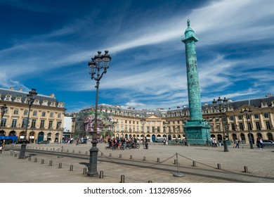 Paris, France - 23 June 2018: Wide angle view of Place Vendome square with blue sky.