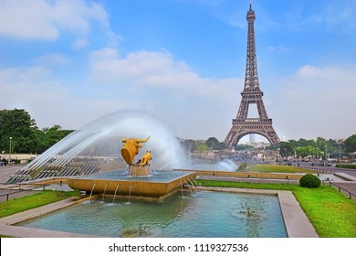 "PARIS, FRANCE -23 may 2018  sculpture ""Taureau et Daim"" (""Bull and Deer"") by french sculptor Paul Jouve, Fountain of Warsaw and Eiffel Tower, Gardens of the Trocadero, Paris"