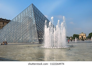 PARIS, FRANCE -23 may 2018 :  Glass Pyramid and the fountain before the Louvre Museum . The museum was inaugurated in 1739
