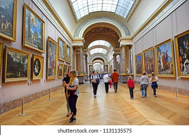 PARIS, FRANCE -23 may 2018: tourists visiting the world's masterpieces of painting in the Louvre Museum in Paris, France. The Louvre is the world's largest museum and a historic monument in Paris
