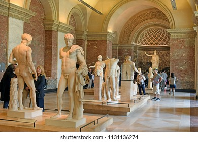 PARIS, FRANCE -23 may 2018: tourists visiting the world's masterpieces of sculpture and the famous Athena Pallas Velletri in the background, Louvre Museum in Paris, the Louvre is the world's largest m