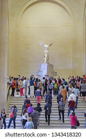 PARIS, FRANCE -23 may 2018: tourists take pictures Winged Victory of Samothrace, called Nike of Samothrace, the Daru staircase, Louvre Museum in Paris