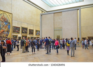 PARIS, FRANCE -23 may 2018: tourists visiting the world's masterpieces in the hall of Mona Lisa by Leonardo DaVinci, Louvre Museum in Paris, France