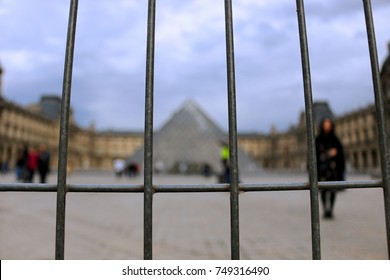Paris, France - 23rd March, 2017; A fence in front of the blureed Louvre in Paris. Since some terror attacks, the Attractions get a higher secure level.