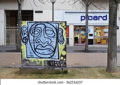 PARIS, FRANCE -24 DEC 2015- Colorful graffiti street art murals in Paris.