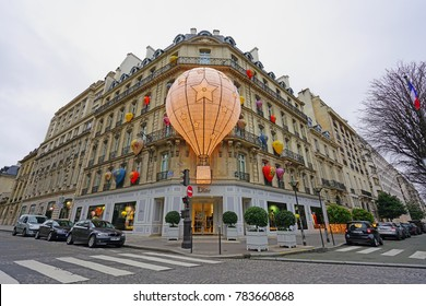 PARIS, FRANCE -24 DEC 2017- View of the landmark Christian Dior flagship headquarters fashion store on Avenue Montaigne in Paris, France. It is decorated with hot air balloons for the holidays.