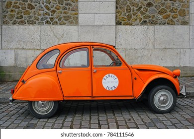 PARIS, FRANCE -24 DEC 2017- View of an old iconic Citroen 2CV car in Montmartre in Paris.