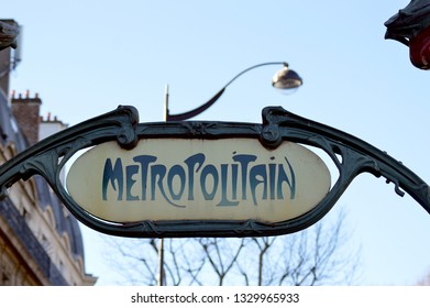PARIS, FRANCE - 24  FEBRUARY 2019:  Metropolitain, in the famous art nouveau font, advertising an entrance to the Paris Underground train system.