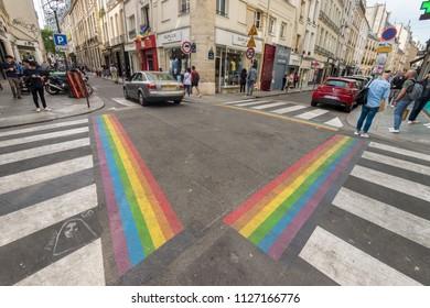 Paris, France - 24 June 2018: Gay pride flag crosswalks in Paris gay village (Le Marais)