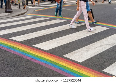 Paris, France - 24 June 2018: Gay pride flag crosswalk in Paris gay village with people crossing