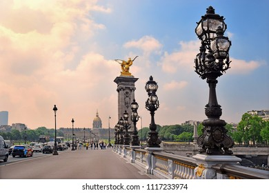 PARIS, FRANCE -24 may 2018 Pont Alexandre III bridge over river Seine and Hotel des Invalides in the background,  bridge decorated with ornate Art Nouveau lamps and sculptures, Paris
