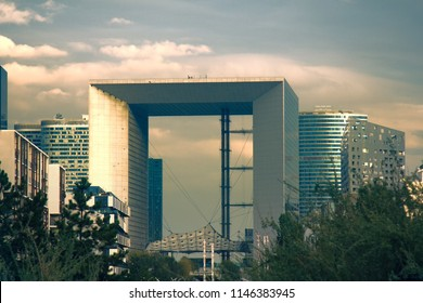 Paris, France - 24.09.2017: Large arch of the brotherhood (La Grande Arche de la Fraternitй), hypercube, tesseract. Defans at sunset time with tall building and high-rise