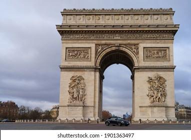 PARIS, FRANCE -25 DEC 2020- View of the Arc de Triomphe, a landmark monument on Place de l'Etoile and the Champs-Elysees in Paris, France.