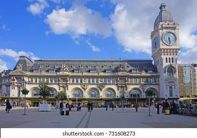 PARIS, FRANCE -27 MAR 2017- Exterior view of the historic Gare de Lyon train station, built for the 1900 Paris World Exposition. It includes the landmark Tour de l'Horloge clock tower.