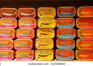 PARIS, FRANCE -28 JUN 2018- View of tins of preserved fish and cans of gourmet seafood spreads in a Conserverie La Belle-Iloise store. The original factory is located in Belle Ile.