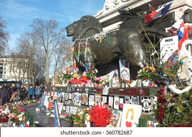 Paris, France - 28th December, 2015: People gather around the statue of Place de la Republique to respect for the people killed during the Paris attacks in Paris.
