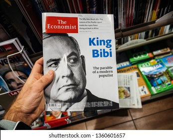 Paris, France - 29 Mar 2019: Man reading The Economist magazine with portrait of Benjamin Netanyahu and ironic title King Bibi a few days before the elections in Israel