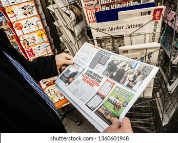 Paris, France - 29 Mar 2019: Newspaper stand kiosk selling press with senior male hand buying latest German Bild featuring Vladimir Kliciko boxer on front cover