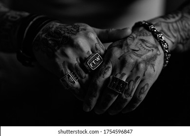 Paris, France - 29112016 - Close-up of the tattooed hands of a male tattoo artist wearing jewelry.