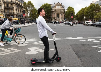 Paris, France- 2nd October, 2019: Tourist on an E-Scooter crossing Saint Michel bridge in Central Paris