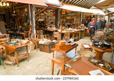 Paris, France - 3 November 2002: People shopping at the flea market of Clignancourt at Paris on France