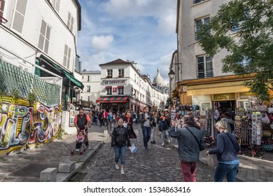 Paris, France - 30th September, 2019: busy shops and resturaunts  in the touristic cobblestone sidestreets area of montmartre in Paris