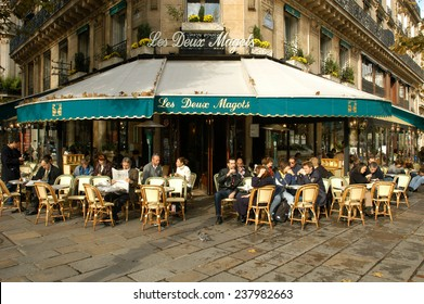 Paris, France - 4 November 2002: People eating and drinking in a street restaurant of Paris on France