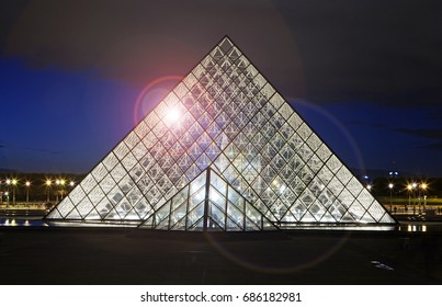 PARIS FRANCE - 4TH NOVEMBER 2016; The iconic Glass pyramid outside of the Louvre illuminated at night, architect I.M Pei