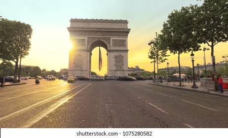 Paris, France - 5 May, 2017: Sunset in Paris city with famous Arch de Triumph traffic circle panorama