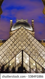 PARIS, FRANCE -6 NOV 2016- Night view of the Pyramide du Louvre, a glass pyramid designed by architect I. M. Pei in the Cour Napoleon main courtyard in the Louvre Museum in Paris.