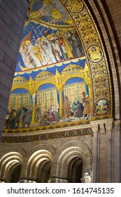 Paris, France - 6th June, 2019: Interior of the Sacre Coeur Basilica with huge mosaic on the wall and ceiling.