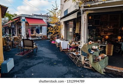 Paris, France- 8th December, 2012: Alleyways and shops of the St-Ouen flea market in Paris, also known as Porte de Clignancourt flea market is one of the largest and most popular in Paris.